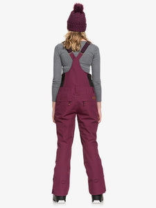 Roxy Women's Rideout Bib Snow Pant Grape Wine Back view modeling