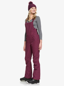 Roxy Women's Rideout Bib Snow Pant Grape Wine angled front view with model