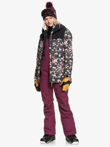Roxy Women's Rideout Bib Snow Pant Grape Wine Modeling jacket over bib view