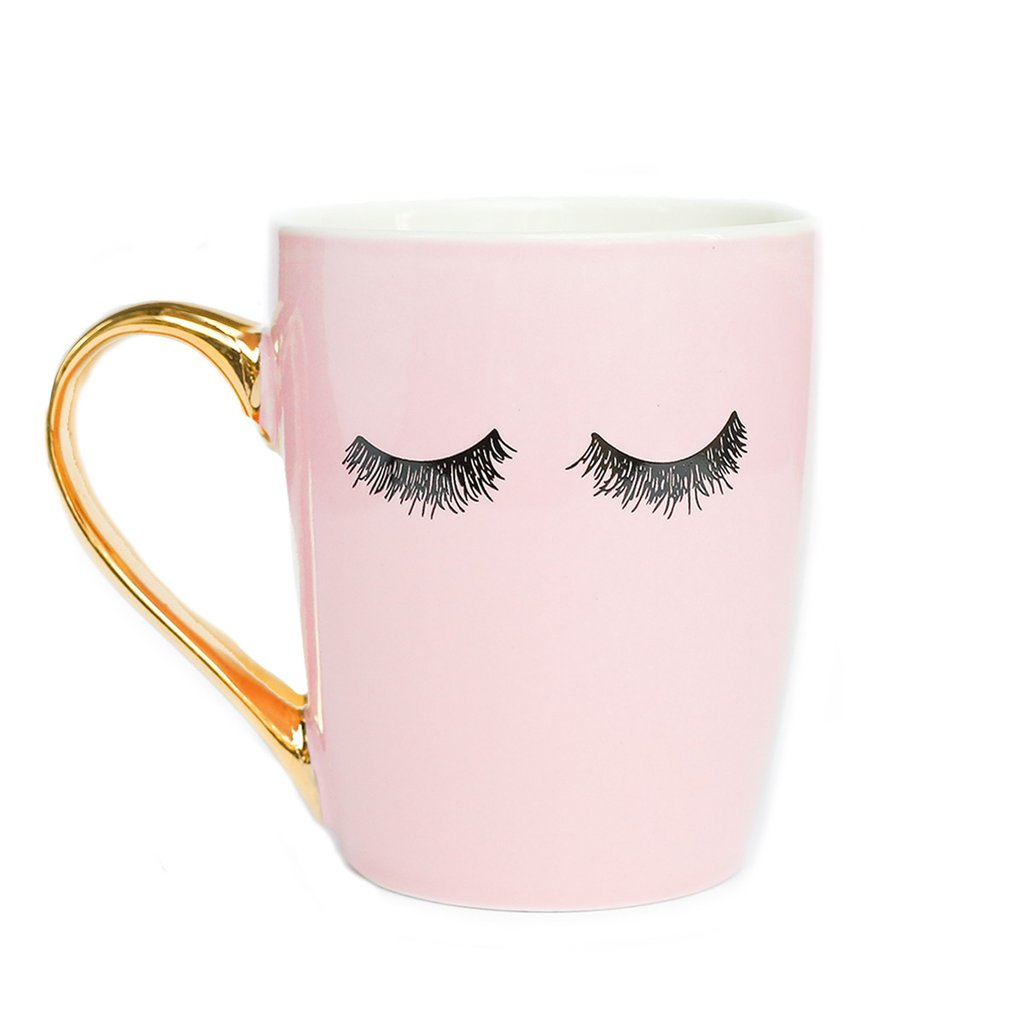 Sweet Water Decor Pink Eyelashes Gold Coffee Mug. Pink Ceramic mug with eyelashes design and gold leaf handle.