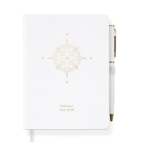 Fringe Studio Find Your Truth North Journal. Soft cover journal with metallic gold design, elastic pen loop with pen and gold gilded edges.