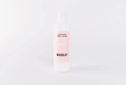 Woodlot Nourishing Lotion - Amour. Scents of floral palmarosa, fragrant rose damask, and spicy black pepper oil make this nourishing and lightweight lotion a romantic treat for your skin.