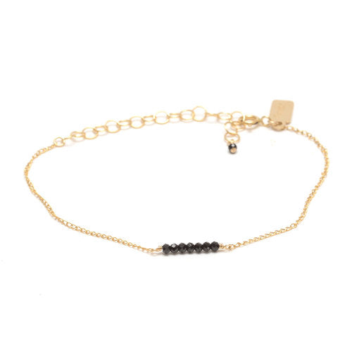 Favor Jewelry Ellipsis Bracelet.  Delicate gold bracelet with black spinel beads