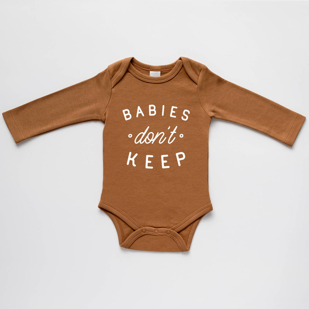 The Oyster's Pearl - Camel Organic Babies Don't Keep Baby Bodysuit