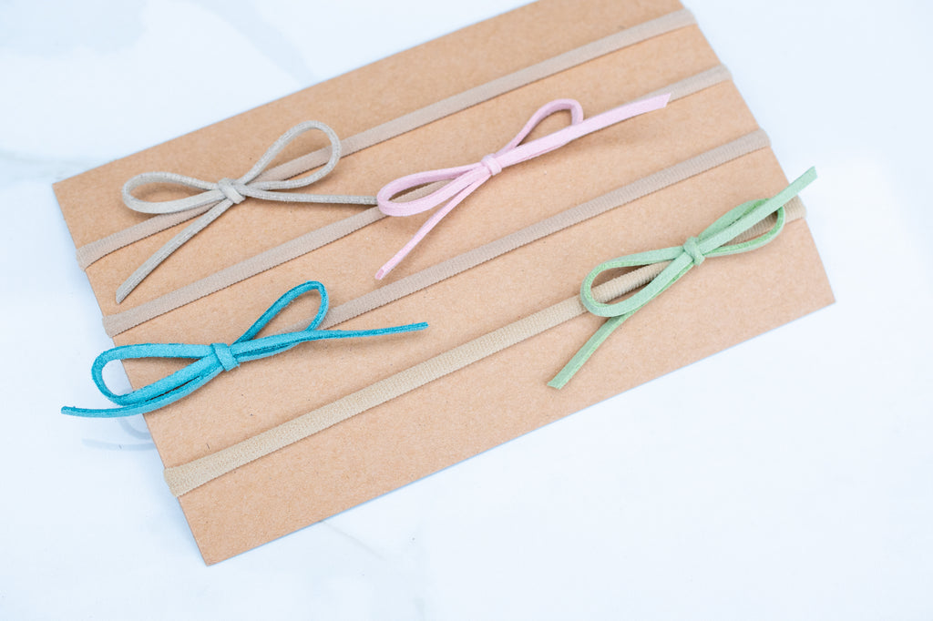 4 Pack- Tiny Suede Cord Spring Bows