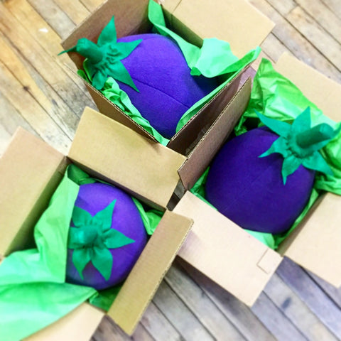Packing eggplants to ship out.