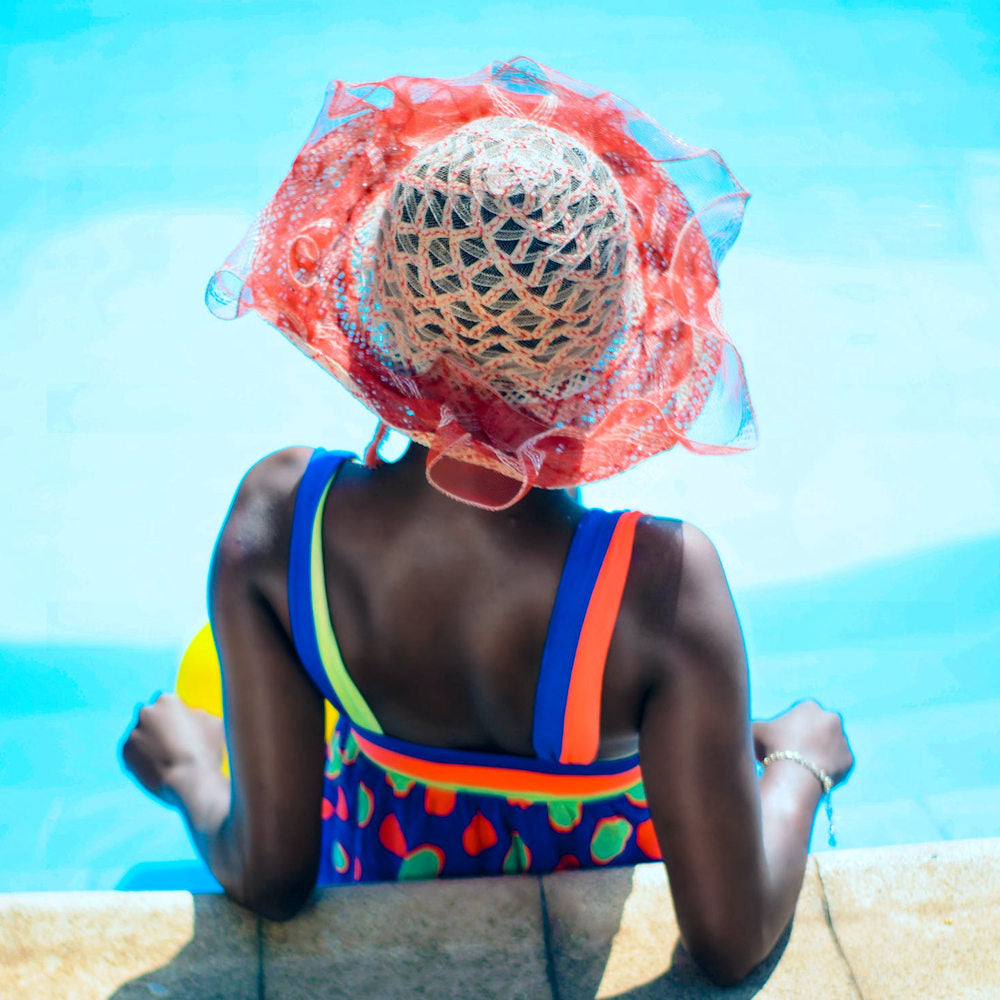 Black women with weaves at the pool
