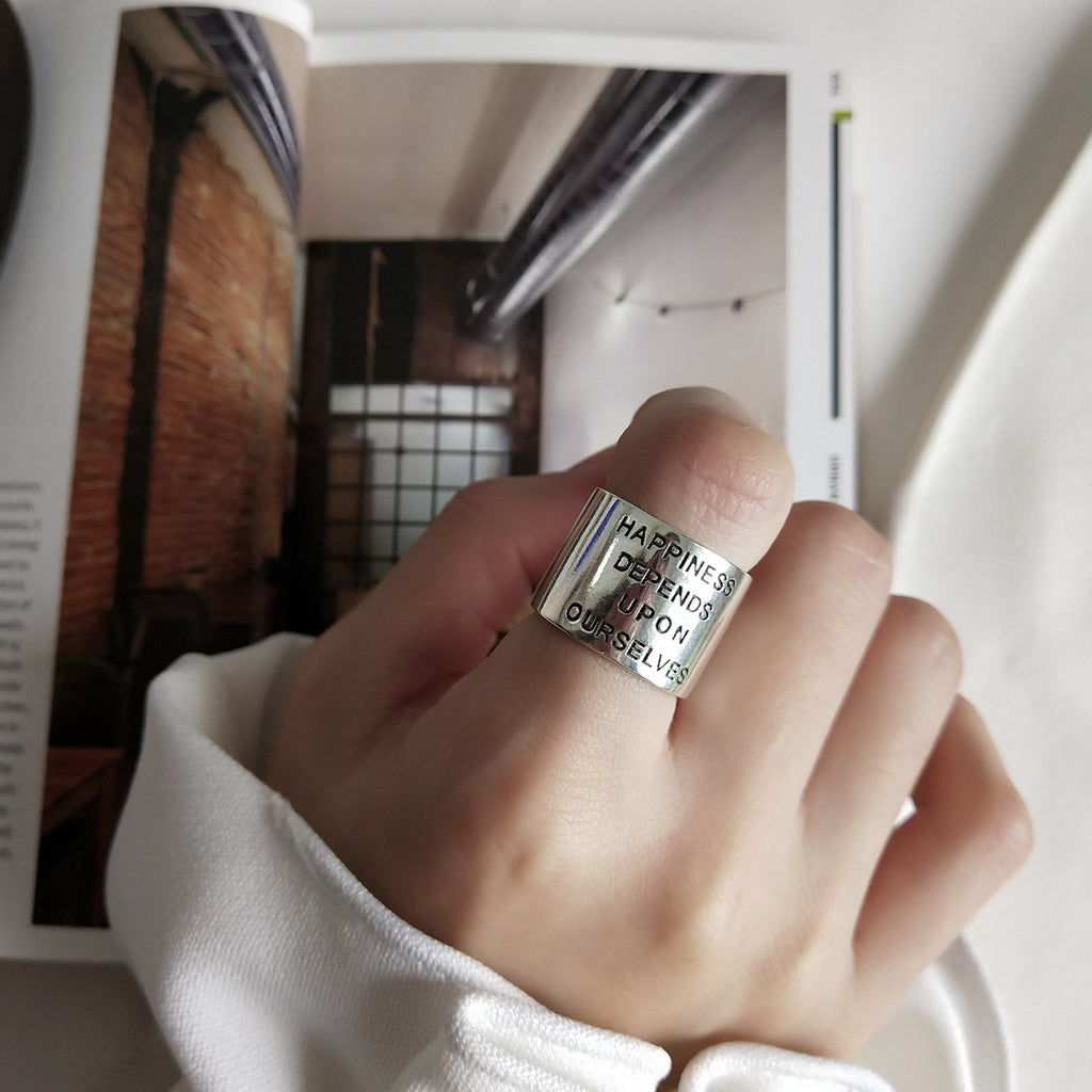 Wide silver ring with quote