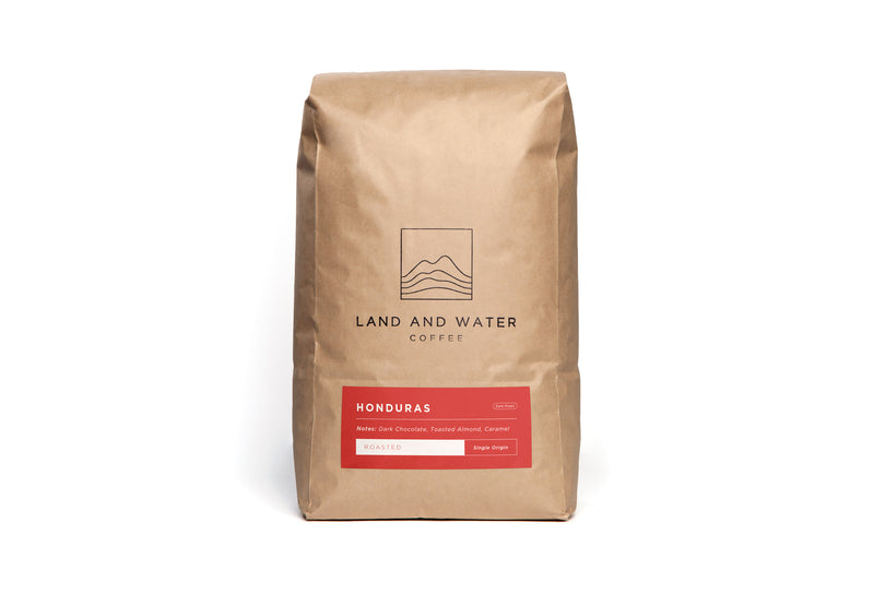 Land and Water Coffee Finca Terrerito, Copan Honduras, White Bag with red label on a red background
