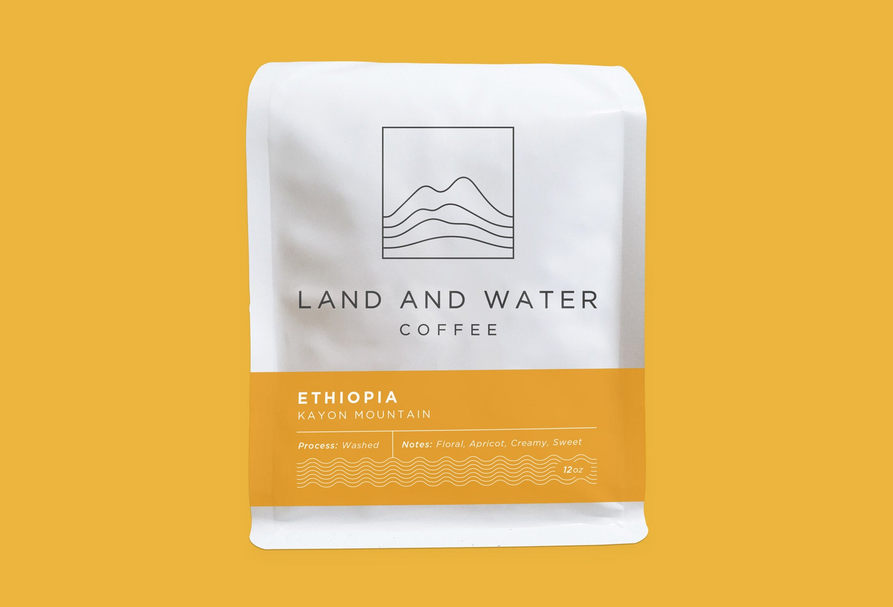 Land and Water Coffee from Kayon Mountain, Guji, Shakiso, Ethiopia white bag with yellow label and yellow background