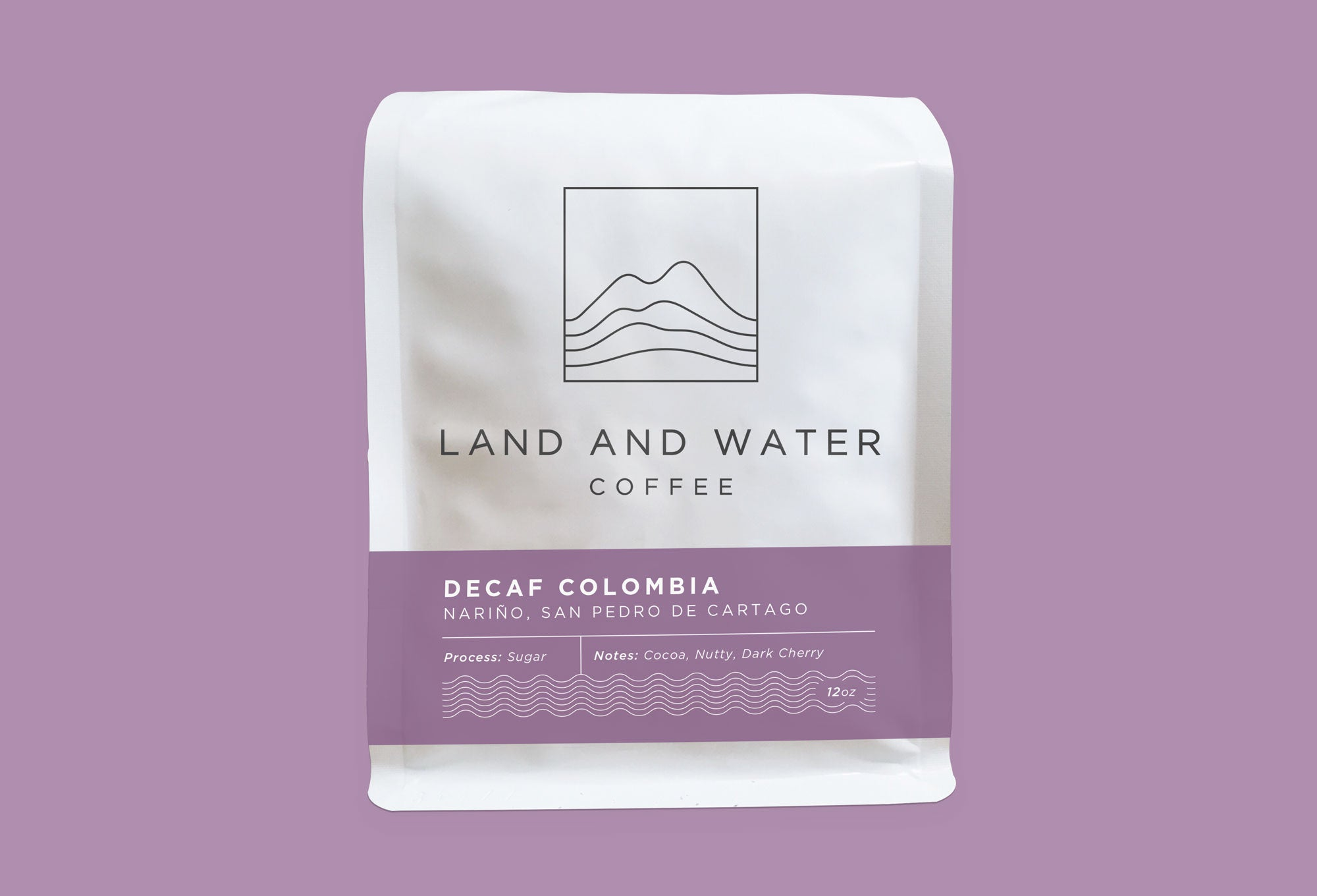 Land and Water Coffee Sugar Decaf Colombia, white bag with purple label and purple background