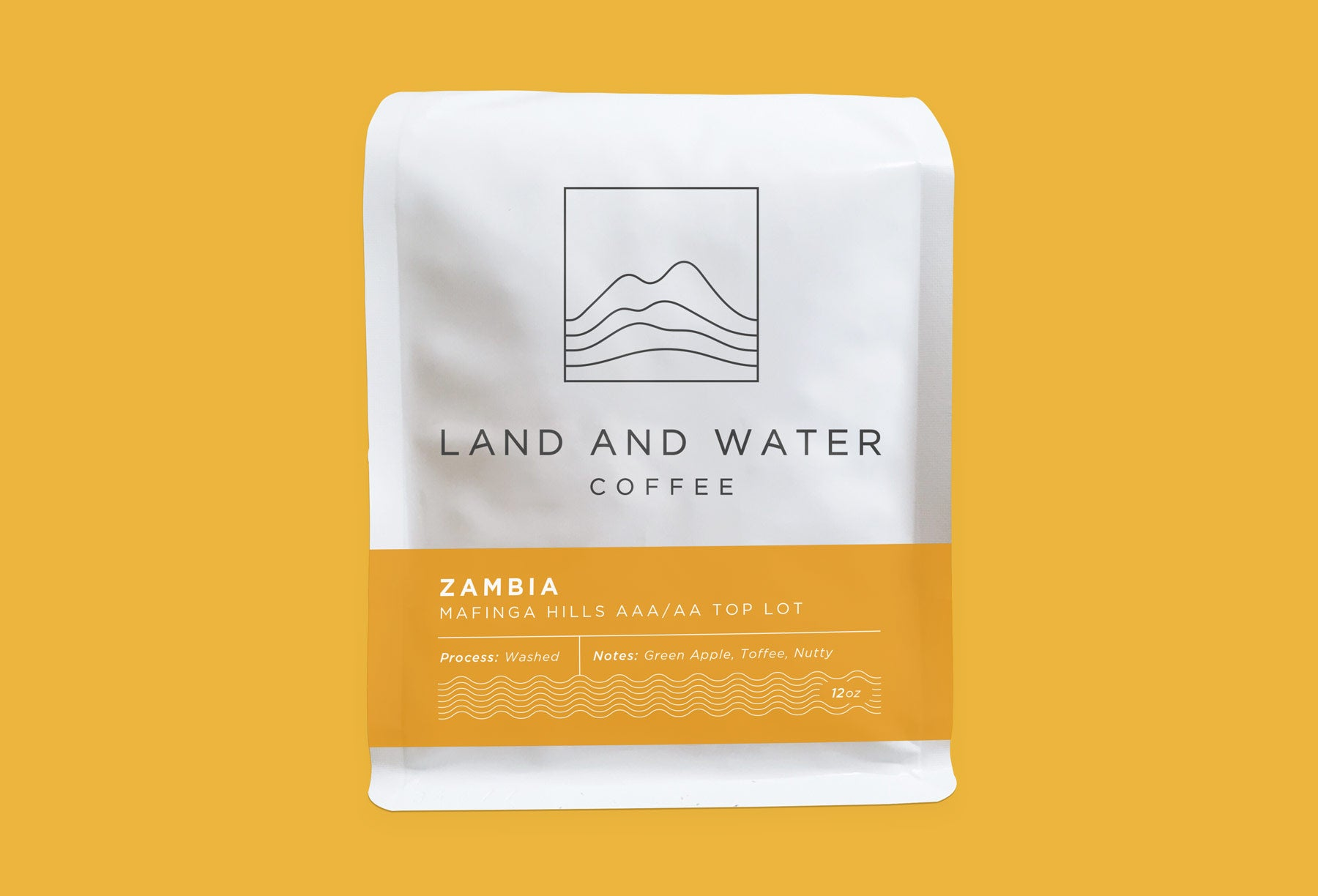 Land and Water Coffee from Mafinga Hills AAA/AA Top Lot, white bag with yellow label and yellow background