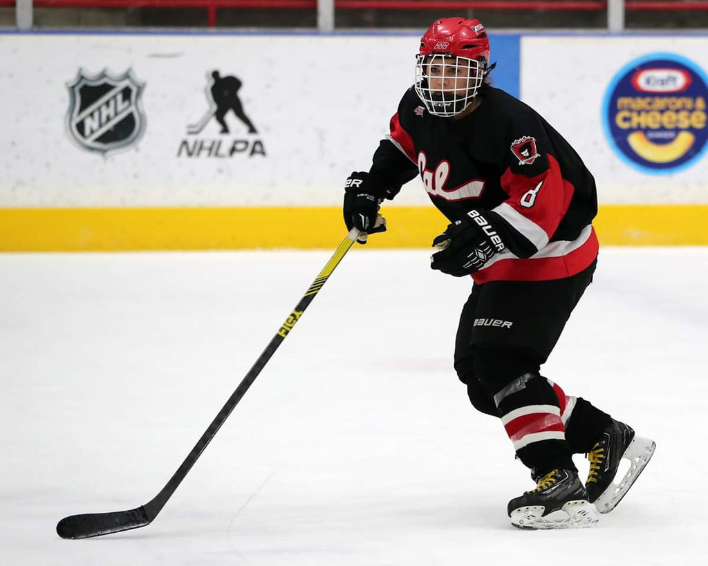 Cal U Hockey Player with Flex Hockey Stick