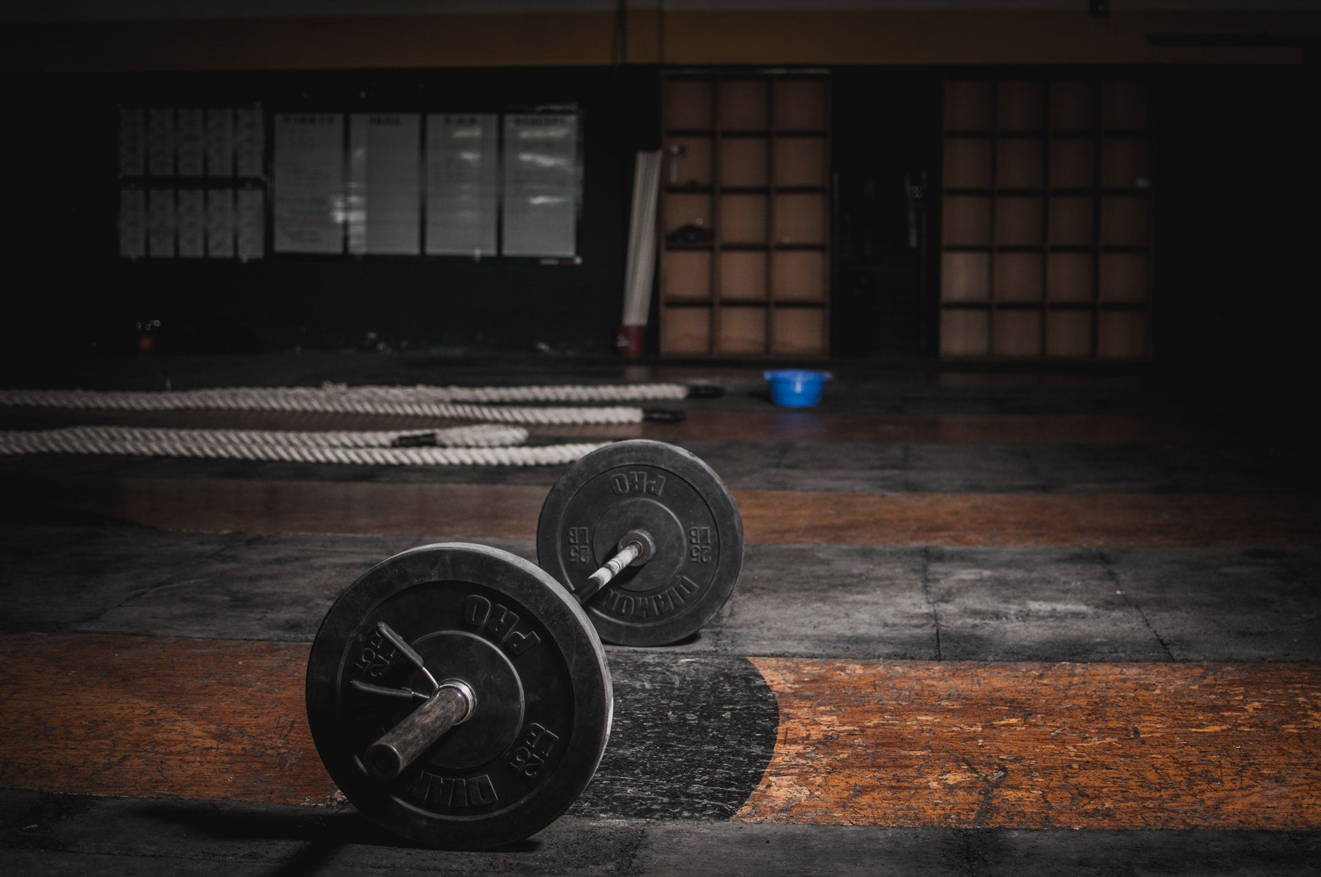 Barbell on the floor in an empty gym