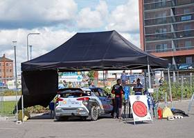 Massive black gazebo tent for car park