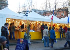 Holiday market stalls using white gazebo tents