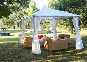 Cosy white gazebo tent in the garden