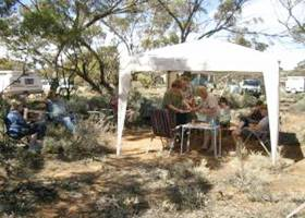 Family picnic using gazebo tent outdoors