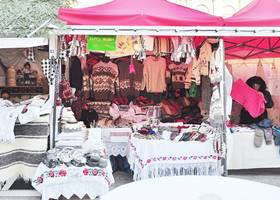 Holiday market stall uses a red gazebo tent use