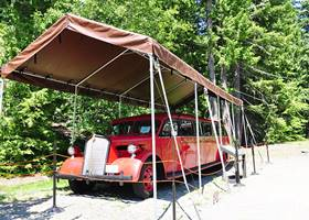 Red vintage car inside red gazebo