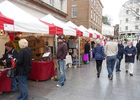 Market stalls using white and red gazebo tents