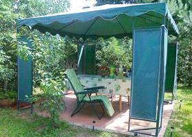Relaxing green gazebo tent in the garden