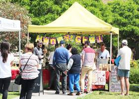 Australia market stall using yellow gazebo