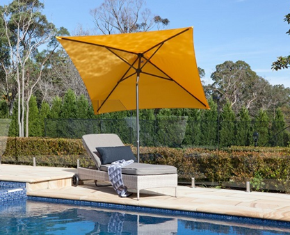 Pool side yellow umbrella