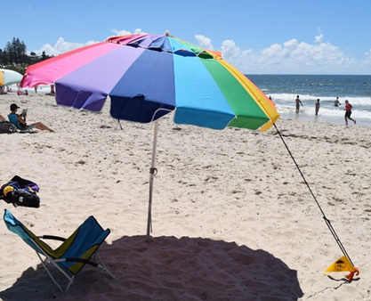 Rainbow coloured beach umbrella