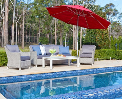 Pool side red cantilever umbrella