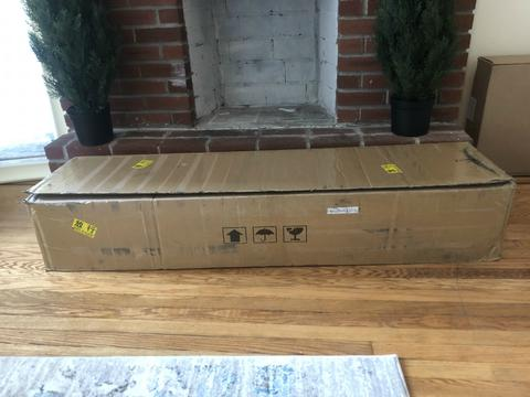 brown box that dolls are shipped in