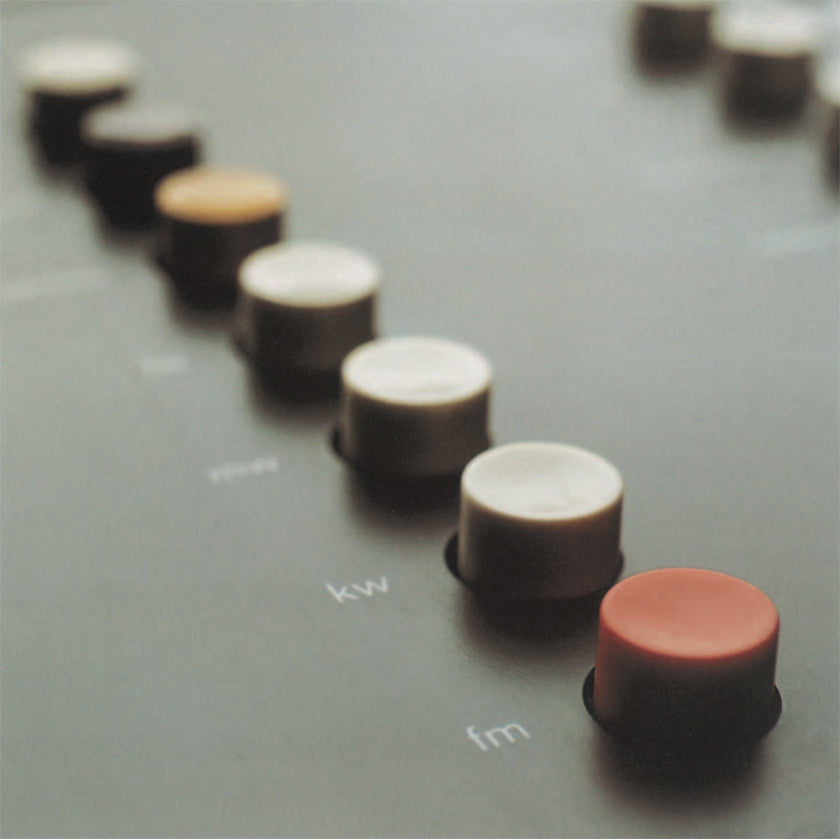 Close up image of color coded buttons of a hi-fi system by Braun. (Design by Dieter Rams, photography by Timm Rautert)