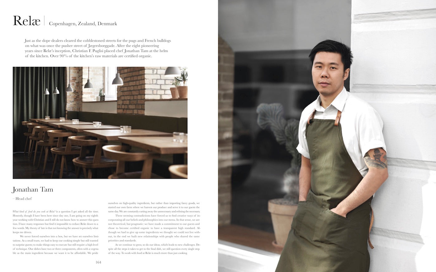 Head chef of Relæ Restaurant Jonathan Tam standing, wearing his cooking uniform and a green apron. (Photo: Michael Jepsen)