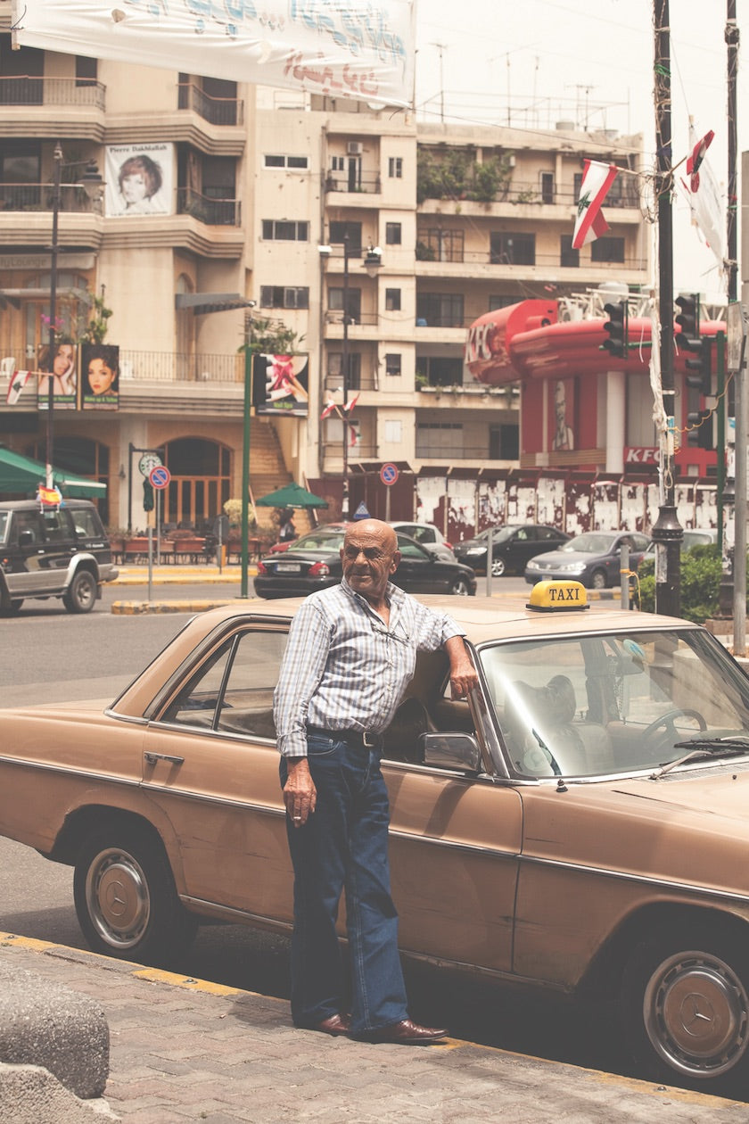 Taxi driver standing in front of and old Mercedes Benz taxi on the streets of Beirut, Lebanon. (Photo: Monocle)