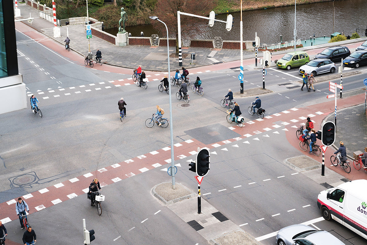 "Cyclists riding on the four ""smart routes"" over a crossroad in the Dutch city of Groningen. (Photo: Monocle 2018)"