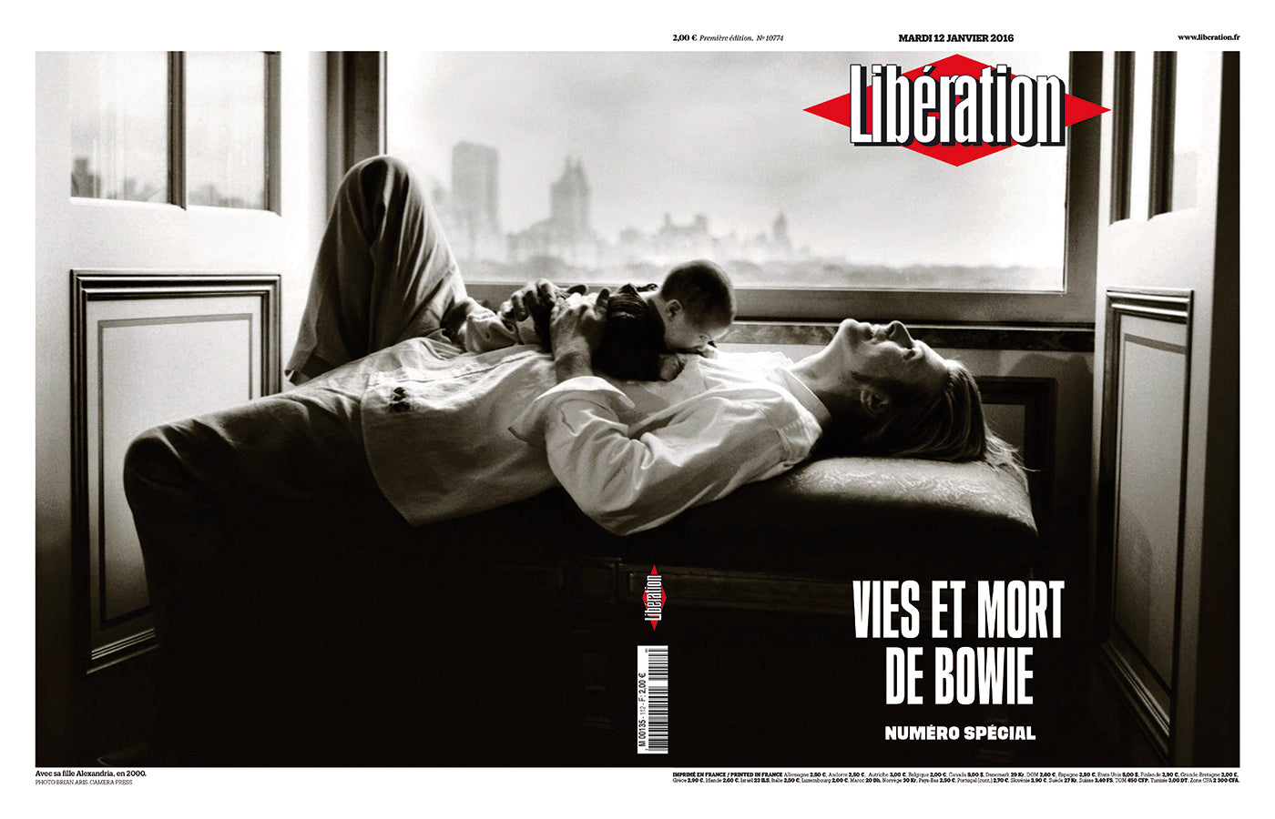 David Bowie on the cover of French newspaper Libération on the occasion of the artist's death in 2016. His infant daughter lying on his stomach. (Photo: Libération)