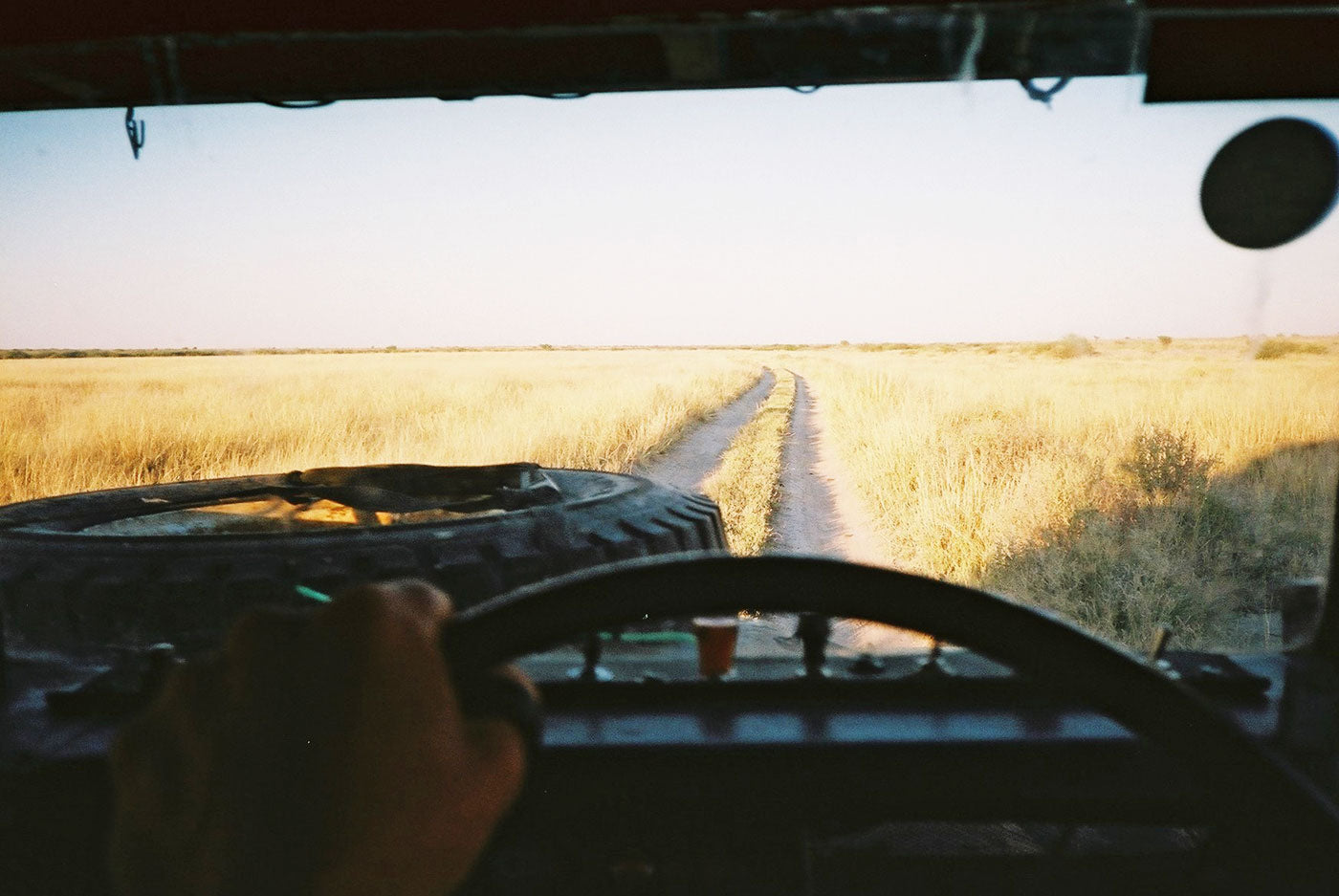 View from the steering wheel outside. Empty rough road in Botswana. (Photo: Lille-Gramberg-Danielsen & Lukas Beuster)