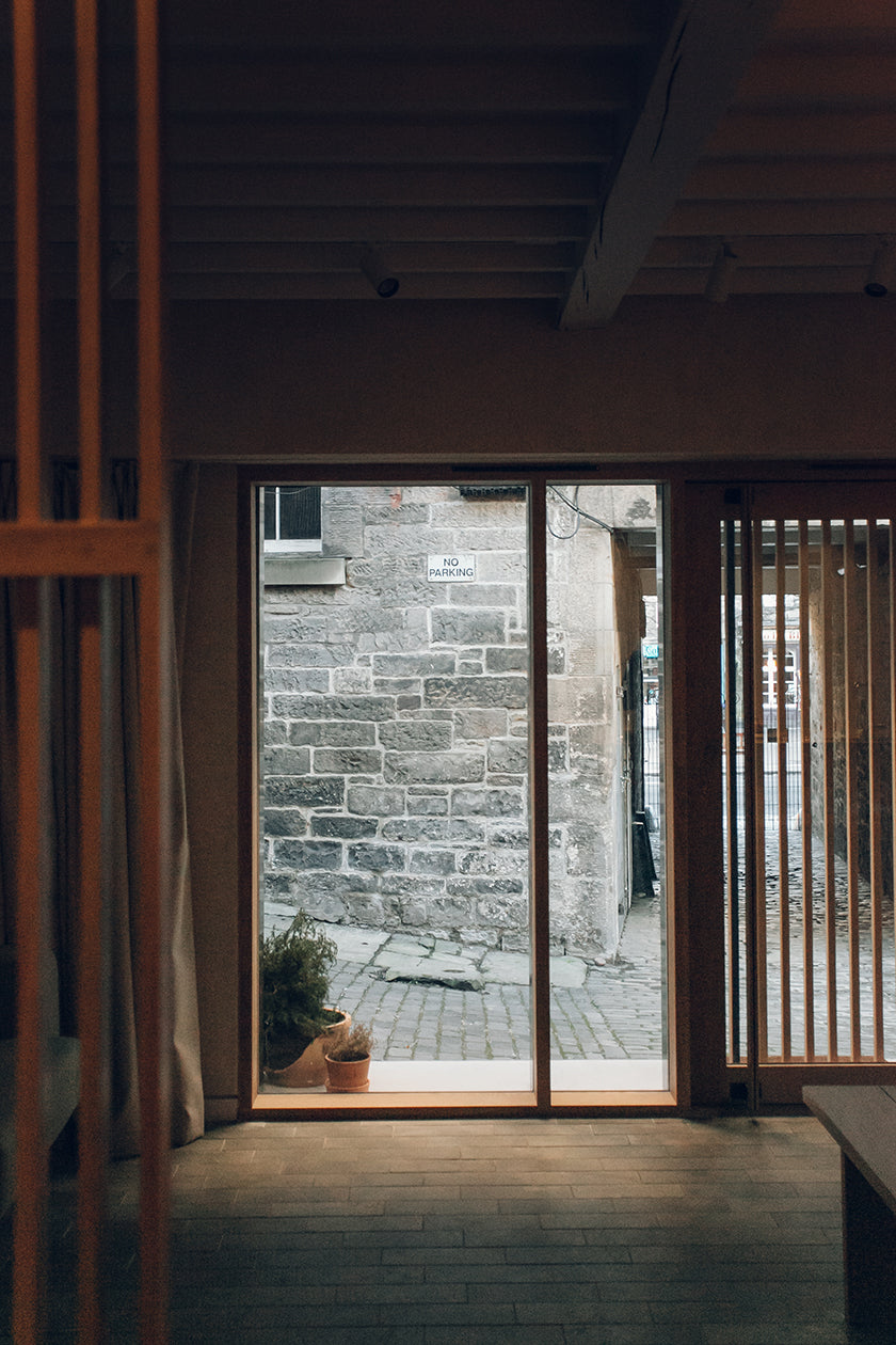 Shot of a timber door in a studio designed by Izat and Arundell in Edinburgh. (Photo: Haarkon)