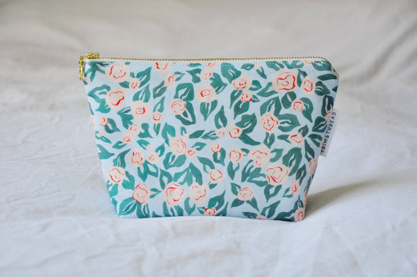 Roses On Misty Blue Cosmetic Pouch