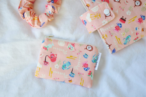 Objects In Pink Coin Pouch