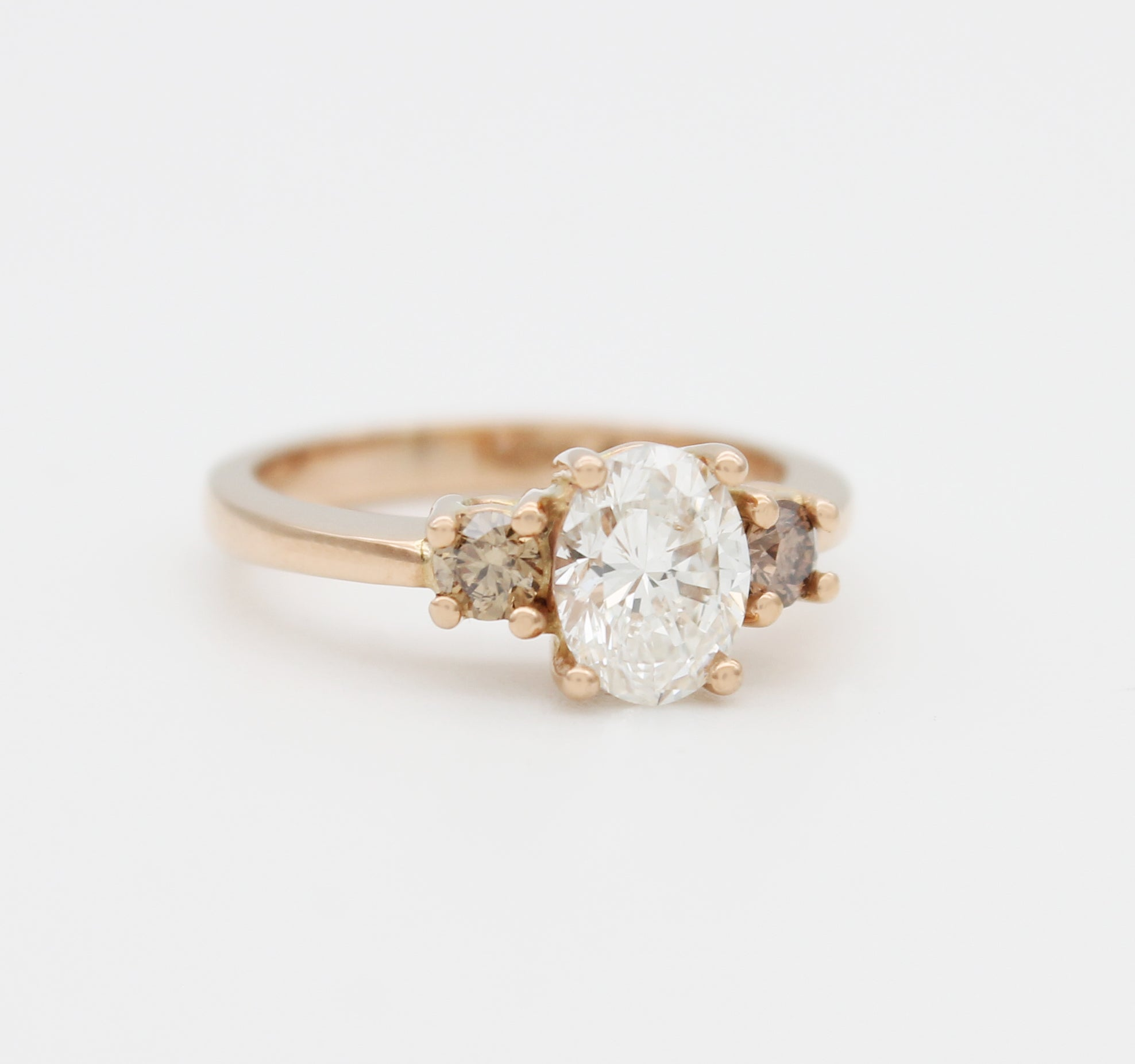 Oval diamond cognac champagne rose gold trilogy ring