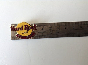 Key West Classic Logo (#361B9) Classic Yellow Logo - Brown Letters & Bar Hard Rock Café