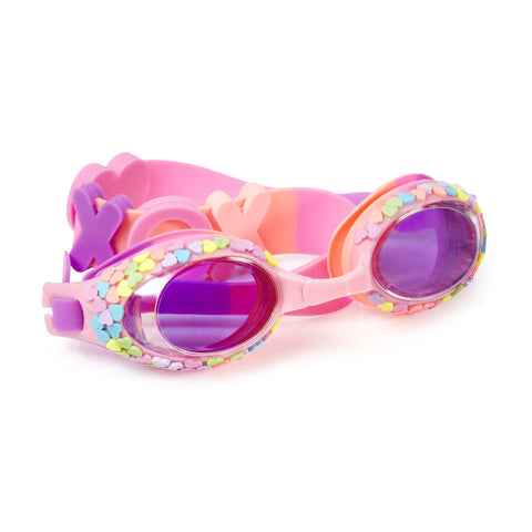 Pink swimming goggles with mini love heart details around lens and XOXO design on head strap