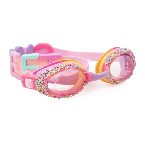 Pink swimming goggles with thousand island features around lens and sweet text on head strap