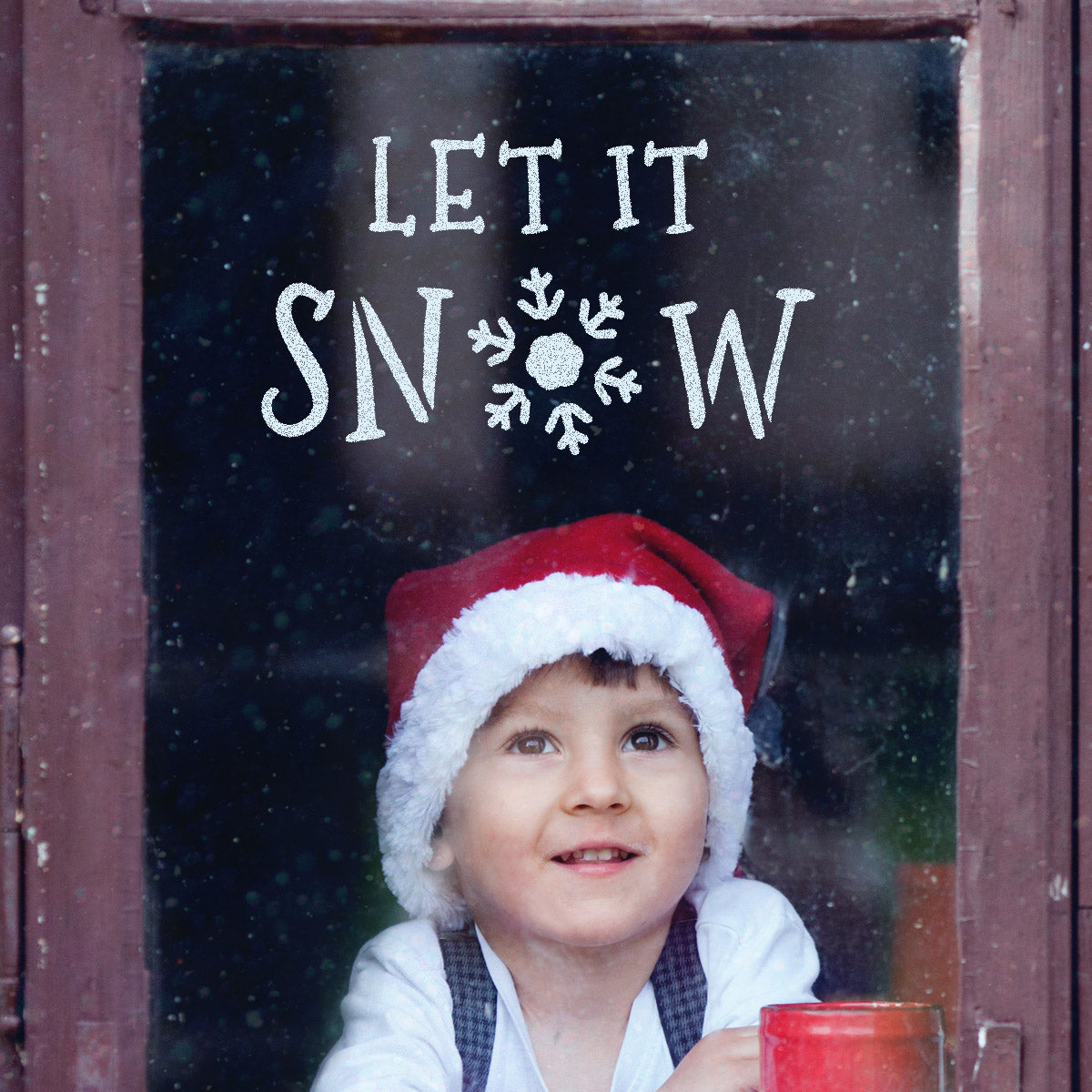 CraftStar Let It Snow Christmas Text Stencil on a Window