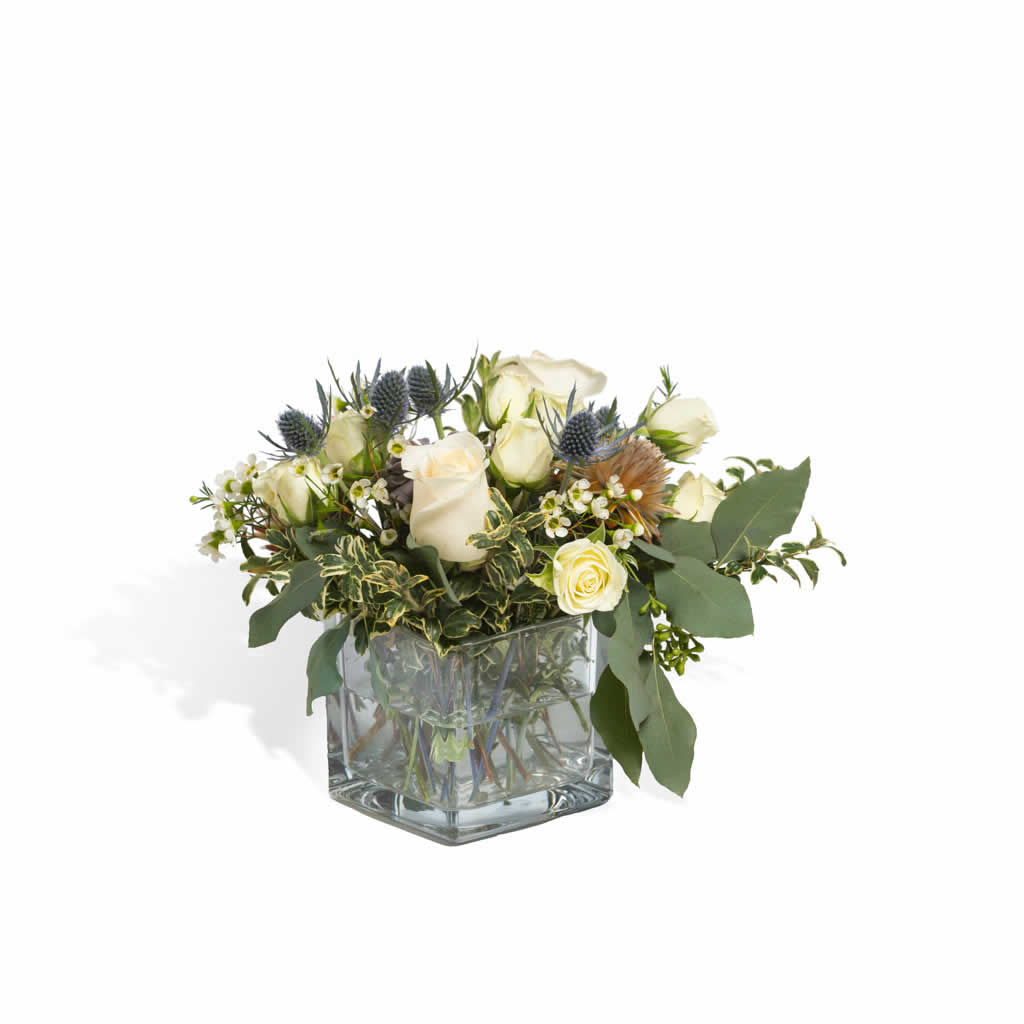White Roses Blue Thistle Centerpiece Blume Designed By Victoria