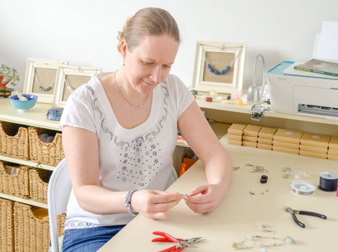Gemma making jewellery by hand in her workspace