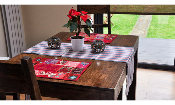Red, white, grey woven table runner with khambadia patchwork red tablemats & crystal tealightsin black