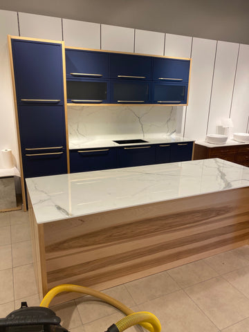 Navy Blue contemporary kitchen cabinets and wood island by evos boutiques