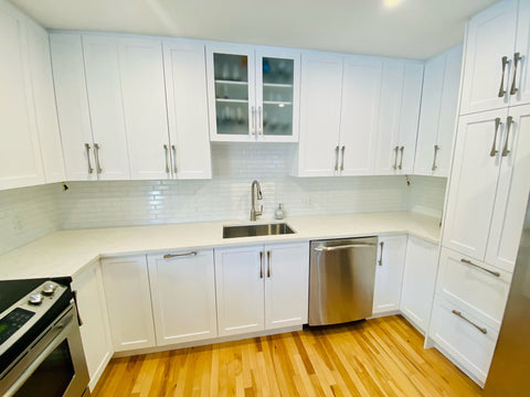 White kitchen cabinets by Evos Boutiques